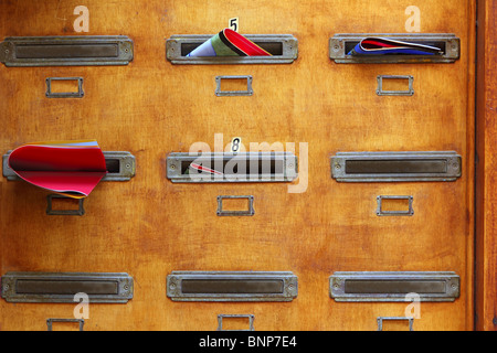 aged mailboxes spain condominium wooden wall rusty brass - Stock Photo