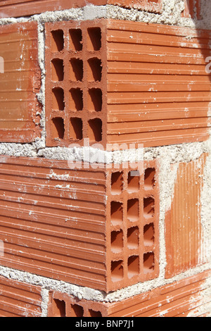 brick corner edge red construction clay bricks hollow airbrick - Stock Photo