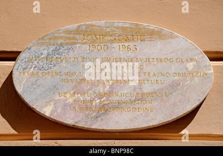 Zagreb, Croatia. Marble plaque commemorating former home of Josip Gostic (Slovene operatic tenor; 1900-1963) - Stock Photo