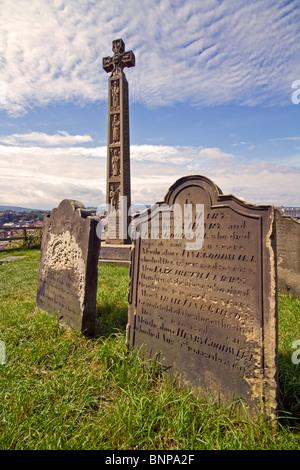 The Caedmon Cross in the St Marys Church Graveyard,Whitby,Yorkshire - Stock Photo