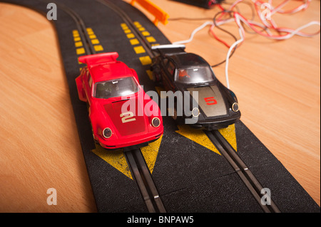 Two Porsche Turbo model cars from a Hornby Scalextric racing car set game in the Uk - Stock Photo