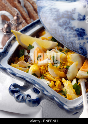 Serving dish of kedgeree with toast - Stock Photo