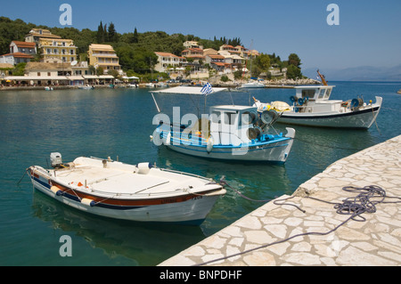 Local inshore fishing boats moored in harbour at Kassiopi on the Greek Mediterranean island of Corfu Greece GR - Stock Photo