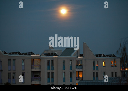 The Moon over an apartment building in Tempelhof, Berlin, Germany - Stock Photo