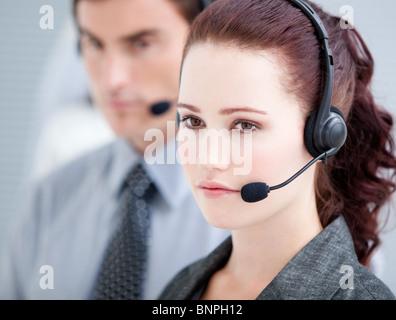Assertive customer service representatives standing in a line - Stock Photo
