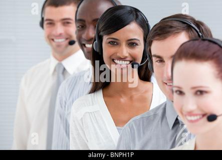 Customer service representatives standing in a line - Stock Photo