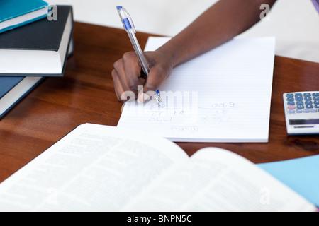Close-up of an girl doing her homework - Stock Photo