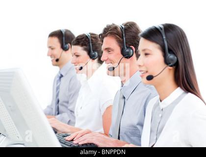 Smiling customer service representatives team - Stock Photo