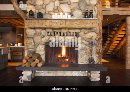 Rustic Fireplace in Log Cabin - Stock Photo
