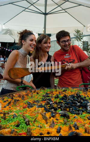 Arles, France, People on Terrace of Spanish Provincial Bistro Restaurant, Front of Paella Being Cooked - Stock Photo