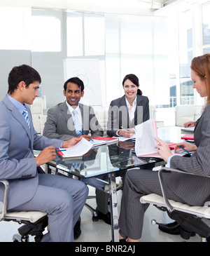 Business team studying a new business plan - Stock Photo