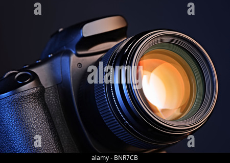 Digital camera with a lens - Stock Photo