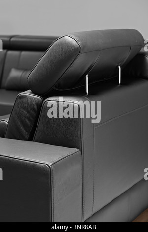 A detail of modern leather black sofa - Stock Photo