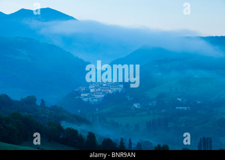Pre-dawn mist over the Medieval town of Preci in the Monti Sibillini National Park, Umbria Italy - Stock Photo