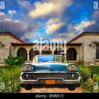 Front view in vintage american car parked in tropical residence, cuba - Stock Photo