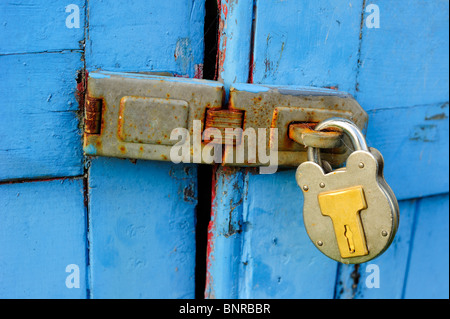 Padlocked wooden doors. Space for text on the wood of the doors - Stock Photo