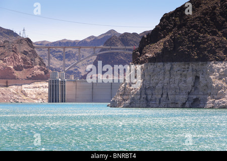 USA Nevada - Hoover Dam seen from Lake Mead cruise. Light rock zone is high water mark. Water low June 2010 due - Stock Photo