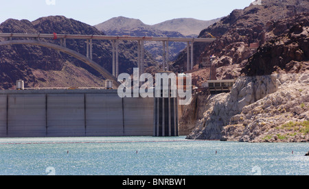 USA Nevada - Hoover Dam seen from Lake Mead cruise. Light rock zone is high water mark. - Stock Photo