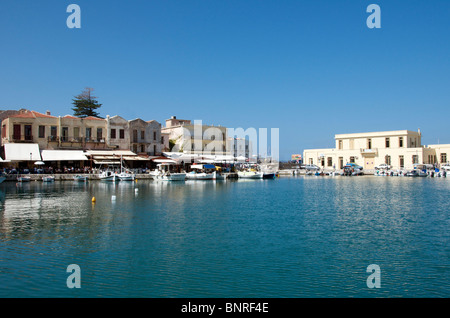 Waterfront restaurants and Customs House Old Harbour Rethymnon Crete Greece - Stock Photo