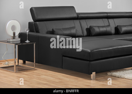 A leather black sofa - Stock Photo