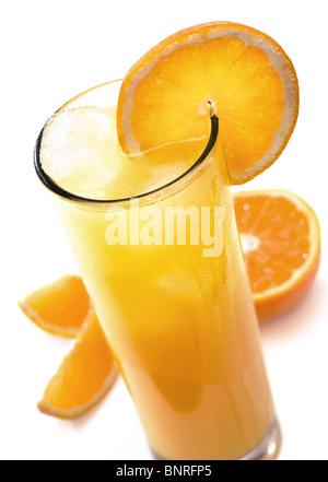 Glass of icy orange juice with orange slice (isolated against white) - Stock Photo