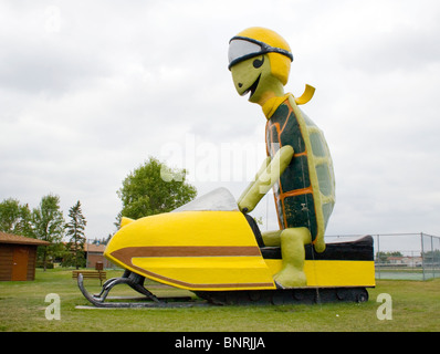 Giant Turtle Riding Snowmobile in Bottineau North Dakota - Stock Photo