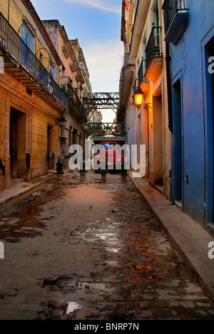 View of messy street of havana with old truck parked in the background - Stock Photo
