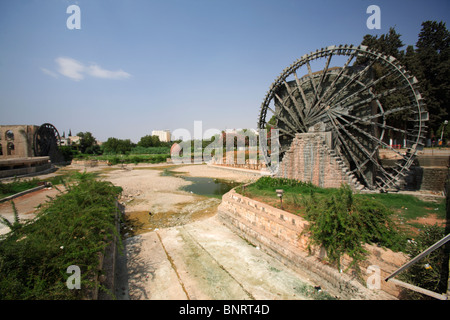 Giant wooden waterwheels aka Norias, on the Orontes River, Hama, Syria - Stock Photo