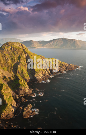 Evening light on the south side of the island Runde in Herøy kommune, Møre og Romsdal, Atlantic west coast of Norway. - Stock Photo