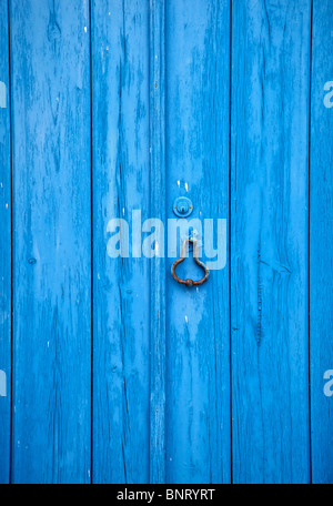 Closeup Details of a Blue Wood Rustic Wood Door of the Medieval Village of Obidos - Stock Photo