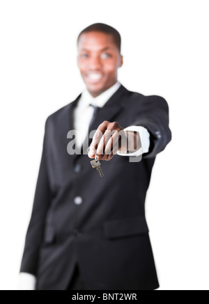 Young businessman holding a key - Stock Photo