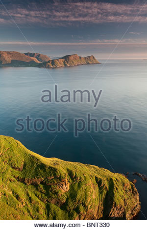 Last evening light on the south side of the island Runde in Herøy kommune, Møre og Romsdal, west coast of Norway. - Stock Photo