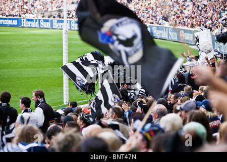 Supporters cheer on their teams during an Australian Rules Football game.  Melbourne, Victoria, AUSTRALIA.