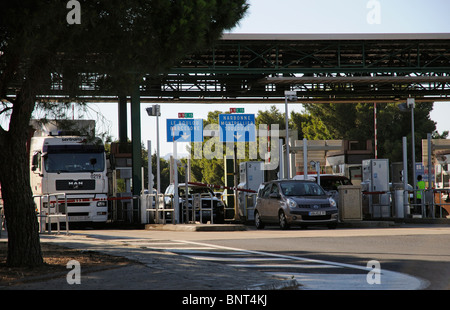 Traffic exiting a pay station on the A9 Autoroute at Perpignan southern France - Stock Photo