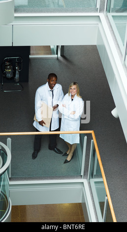 High view of male and female doctors smiling at the camera - Stock Photo