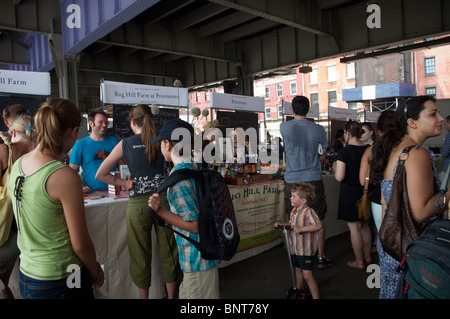 Customers shop at the New Amsterdam Market on South Street in New York - Stock Photo