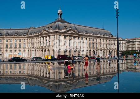 The Water mirror in front of the Stock Exchange Square, Bordeaux, France - Stock Photo