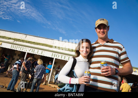 Couple outside the Birdsville Hotel during the annual Birdsville races.  Birdsville, Queensland, AUSTRALIA - Stock Photo