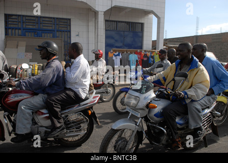 Locals riding Boda bodas motorcycle taxis in the city of Goma in North Kivu province in DR Congo Africa - Stock Photo
