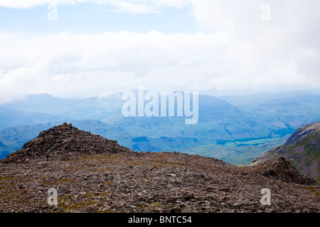 View from summit top of Scafell Pike, looking south towards South Peak with Harter Fell in the centre midground. - Stock Photo