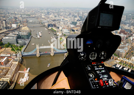 Aerial shot London Bridge from a Robinson R44 helicopter cockpit . - Stock Photo