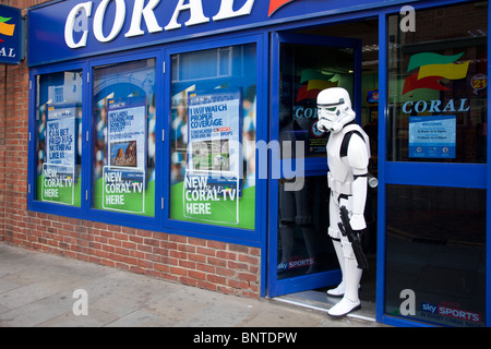 Coral Bookmakers, displaying odds with Storm-trooper standing in doorway at STOCKTON International Riverside Festival - Stock Photo