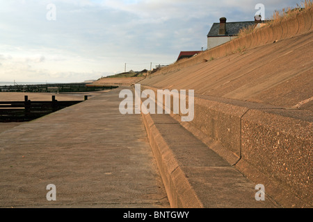 Substantial concrete sea wall for coast protection at Bacton on sea, Norfolk, England, United Kingdom. - Stock Photo