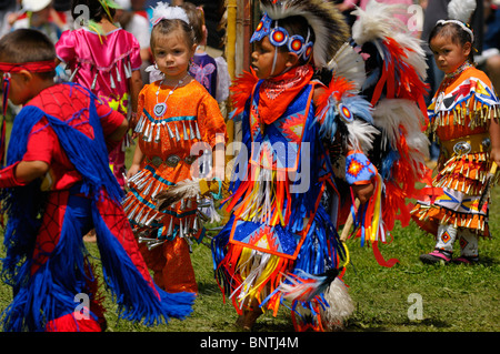 Young children Native Indian dancers in tiny tots competition at Six Nations Reserve Pow Wow Grand River Ontario - Stock Photo