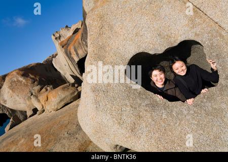 Tourists have fun at Remarkable Rocks on the south coast of Kangaroo Island, South Australia, AUSTRALIA. - Stock Photo