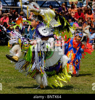 Young Native Indian boys dancing in tiny tots competition at Six Nations Reserve Pow Wow Grand River Ontario - Stock Photo
