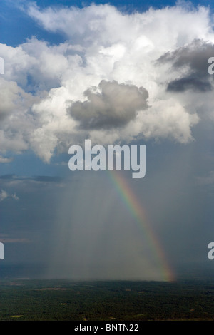 aerial view above rainbow rain pouring from cumulonimbus cloud Alabama - Stock Photo