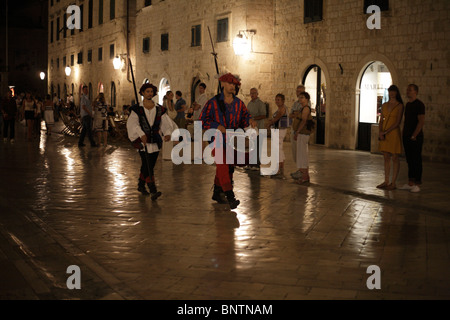 Night in the old town of Dubrovnik Croatia ceremony of changing the guard in historic costume - Stock Photo