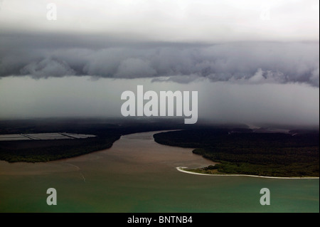 aerial view above thick fog bank layers mouth of river Pacific coast Panama - Stock Photo