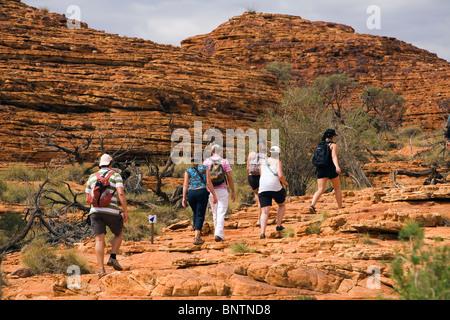 Hikers on the Kings Canyon Rim Walk. Watarrka (Kings Canyon) National Park, Northern Territory, AUSTRALIA. - Stock Photo